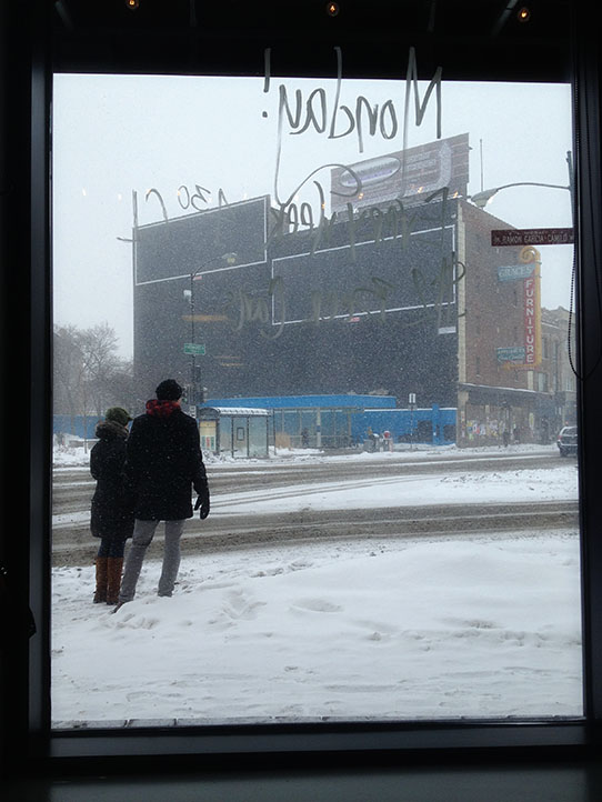 More snow falling in Logan Square
